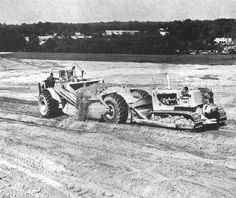 An early production Allis-Chalmers 460C gets a helping hand from an HD-21 on the Baltimore-Washington Industrial Park job site in 1969. The job required 750,000 cubic yards of excavation in good scraper material, sandy loam. Note that the HD-21 has a cable-controlled blade.
