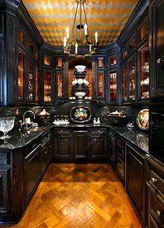 Bella Sera mansion Old World Victorian kitchen interior with dark wood . Bella Sera mansion Old World Victorian kitchen interior with dark wood .