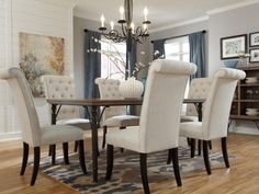 Dining Room Table: Tripton 7-Piece Dining Set by Ashley Furniture at Kensington Furniture. I'm absolutely in LOVE with this dining room decor!