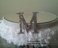 "Wedding Cakes Stand - White. Adorned with crystal and silk. Monogrammed ""M"" with mirror top. Available in sizes up to 24"" Kreative Crafts"