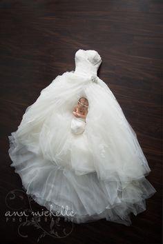 Sweet newborn girl with Mommy's Wedding Dress  www.annmichellephoto.com