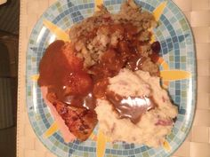 Turkey, garlic mashed potatoes, and cranberry stuffing topped with brown turkey gravy.