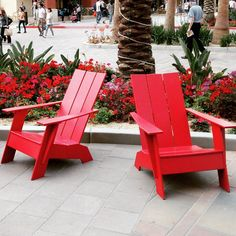 Red modern Loll Adirondack chairs spotted in California. Loll Designs' modern outdoor furniture is made in the USA from 100% recycled plastic milk jugs.