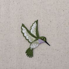 Hummingbird Iron on Applique High quality, detailed embroidery applique. Can be sewn or ironed on. Great for bags, hats, clothing, and more! Measures x x Facing Left or Right Japanese Embroidery, Hand Embroidery Stitches, Silk Ribbon Embroidery, Crewel Embroidery, Hand Embroidery Designs, Embroidery Patterns, Machine Embroidery, Brazilian Embroidery, Iron On Applique