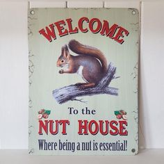 WELCOME TO THE NUT HOUSE WHERE BEING A NUT IS ESSENTIAL FUN METAL SQUIRREL SIGN