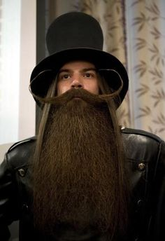 JONATHAN NACKSTRAND / AFP/GETTY IMAGES Burke Kenny poses after winning first place of the natural full beard with styled mustache category at the Beards and Mustaches World Championship 2011.