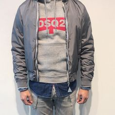New Arrivals by #Moncler & #Dsquared2 - This grey lightweight jacket is an ideal choice of outerwear to suit a variety of styles combined with this comfortable hooded sweatshirt features long sleeves and a red Logo DSQ2 printed to the front for the Spring Summer 2018 collection.  Discover more at https://www.credomen.com/moncler #new #arrivals #moncler  Discover more at https://www.credomen.com/dsquared2 #new #arrivals #dsquared2