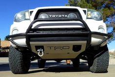 Front skid plate and tow point. Nothing too heavy duty, just enough to deal with a real problem. Get a skid plate without the cheesy TRD logo. 2010 Toyota Tacoma, Tacoma 4x4, Tacoma Truck, Toyota Trucks, Toyota Cars, New Trucks, Cool Trucks, Tacoma Accessories, Truck Accessories