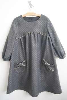 Adorable dress with piping and bow pockets