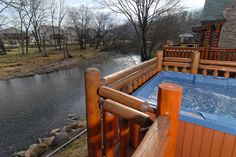 Pigeon Forge Tennessee River Cabin that features a hot tub and fire pit. Call today to reserve for your own private get together. Toll Free 1-877-774-4121.