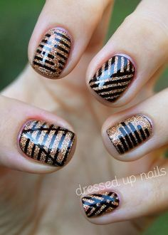 Gold and black stripes. I like the designs by I think instead of having them all at once I would have only 2 designs at a time. Like 1 design on my thumb and another on my ring finger then just that gorgeous base color on the rest of my nails