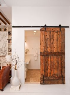 closet doors ideas | Dark stained wood door on black iron railing that creates a rustic ...