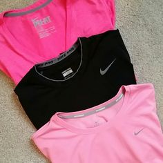 Size small Nike Bundle Tops DARK PINK: regular fit in dry fit size small BLACK: Nike Pro poly spandex blend. LIGHT PINK: Nike running line in dry fit. All are in great condition and size small. Nike Tops Tees - Short Sleeve