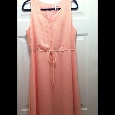 Laura Conrad Maxi Dress This shirt tail hem maxi dress is light peach with a pattern of white daisies on it.  It has a v-neck collar, a slit decorative keyhole on the upper back, is fully lined, and has an elastic drawstring tie waistline.  It is 54 inches long at the longest hem point and is 100% Polyester. Lauren Conrad Dresses Maxi