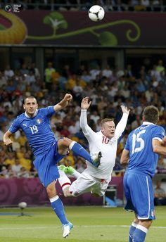 Italy's Bonucci and England's Rooney challenge for a high ball during their Euro 2012 quarter-final soccer match at the Olympic Stadium in Kiev. DARREN STAPLES/REUTERS