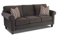 """Crisp tailoring and comfortable pillows add up to stylish comfort on this 83"""" sofa."""