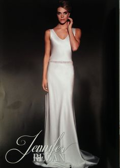 A sleek and sophisticated Jennifer Regan gown in the 6th annual edition of Luxury Weddings magazine