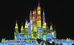 Chinese visitors get a preview of the 25th Harbin International Ice and Snow Festival at a park in Harbin, China on December 24, 2008.