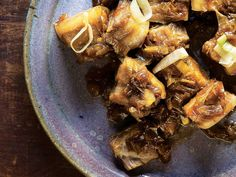 Braised Pork Belly with Leeks and Ginger   Awamori, a lightly sweet rice distillate, is used to blanch and cook—as well as coat—tender pork belly, resulting in a sticky, umami-rich sauce.