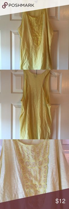 Ann Taylor yellow racerback tank Cute yellow racerback tank with crystal embellishments. Comes from a smoke free and dog friendly home. In great condition and only worn once. Ann Taylor Tops Tank Tops