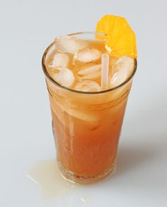 Dubonnet a l'Orange Cocktail - This refreshing, tall drink marries the quinine-fortified aperitif Dubonnet with zesty fresh orange juice, perfect for a sipping on a warm breezy evening.