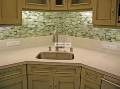 Stone and Pewter 1x2 Glass Tile Backsplash with Caeserstone Countertops