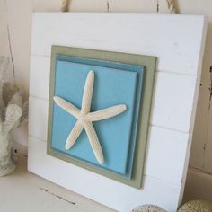 Distressed White Starfish Plank Wall Art by ProjectCottage on Etsy, $49.95
