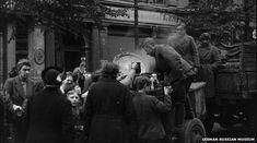 Russian Soldier giving food, Berlin, 1945
