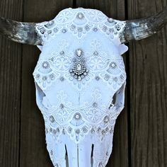 Bleached Cow Skull Venice Lace Detail covering the entire skull Bridal rhinestone detail Indian Wedding Tikka broken apart and placed in the center Bridal rhinestone trim around the horns * horns may