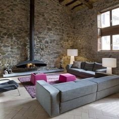 """The MINIM interior design studio executed both the planning of the building and the interior design of this old mill, which was turned into a house and a winery featuring one of the region´s finest wines. The restoration respected the original space and included a bold """"sculpture-staircase"""" in order to organize the building internally."""