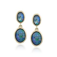 Opals are unlike any other stone in the world. They shift in color and glow with an otherworldly light. Sleek golden settings highlight the boulder opal earrings' varied vibrancy, while the mosaic pattern brings an artsy air to the presentation. >>Click on the opal earrings for more October Birthstone jewelry styles.