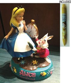 "Disney Parks 10.5"" Tall Alice in Wonderland ""Alice & White Rabbit"" Figure - Disney Parks Exclusive & Limited Availability + Belle Pen Included Disney http://www.amazon.com/dp/B00CPRR3I8/ref=cm_sw_r_pi_dp_x3dowb0WXQCYF"