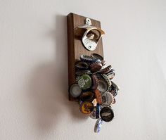 DropCatch Magnetic Bottle Opener ~This magnetic bottle opener will prevent damage to your hardwood by catching those caps with its 60-pound pull-force of magnetic magic, so they never end up underfoot.