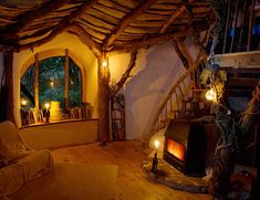 """""""Wales Hobbit House"""" (Direct from article) """"A look inside reveals a cozy living space. Wooden details create warmth, and a variety of light sources achieve a golden glow. For more details on the building of this amazing dwelling, check out BeingSomewhere.net."""""""