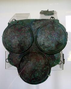 Triple-disc cuirass   Bronze. Paestum, Gaudo necropolis, Tomb 136: a fossa. Male, 25-30 years old. ca. 420-400 BCE Museo Archeologico Nazionale di Paestum