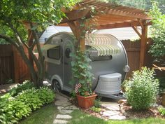What a nice little place for a camper when not in use...and a very cute guest cottage too!
