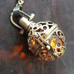 Steampunk FIRE necklace - Girl on Fire pendant charm locket jewelry great for Hunger Games con $29.99
