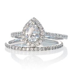 If i were thinking about getting married and we were rich...Pear shaped diamond engagement ring with halo $3,140 Want!!!