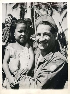 1944- U.S. soldier who participated in the invasion of the Philippines with little girl on Leyte.