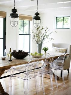 How to mix and match dining chairs: play with weight - Ghost chairs combined with upholstered armchair | Rue