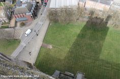 Looking down on the shadow of the Great West Tower from the top of the tower at Ely Cathedral.
