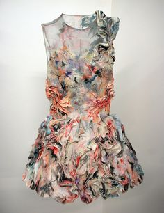 Looks like swirls of paint or melted flowers. #dress #fashion
