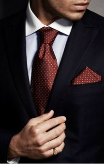 Red tie with a dark suit