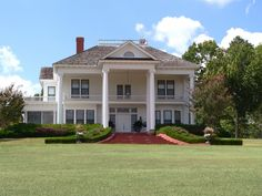 This plantation home has tall columns and a pedimented dormer -- two of the hallmarks of Greek revival style.