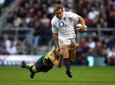 Englands Jonny Wilkinson is tackled by Australias Matt Giteau during the Investec Challenge Series m