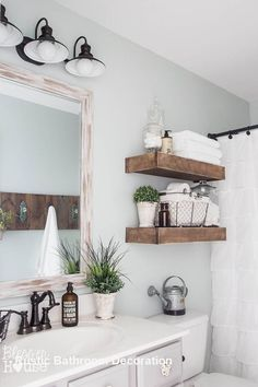 Modern farmhouse bathroom with rustic wood shelving above toilet small bathroom shelving small bathroom shelving ideas . Modern Country Bathrooms, Modern Farmhouse Bathroom, Rustic Bathrooms, Rustic Farmhouse, Farmhouse Style, Farmhouse Ideas, Small Bathrooms, Urban Farmhouse, Farmhouse Furniture