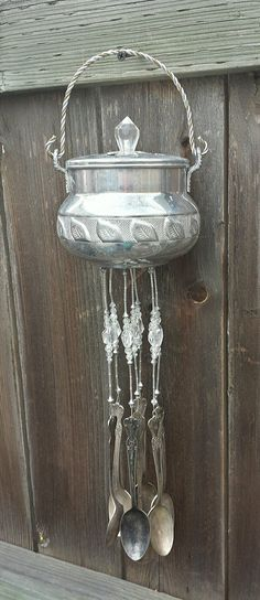 "Scent Pot With Quartz Beads Up-cycled Into A Wind Chime. This stunningly unique chime was made from a scent pot with quartz crystal strung beads. This chime is ""one of a kind"" and would look great on a patio, fence, porch or the kitchen window. The silver plate flatware hanging from the dish are antique spoons. There are 7 spoons. Antique silverware has a brass base which creates the most peaceful sound in a light breeze!."