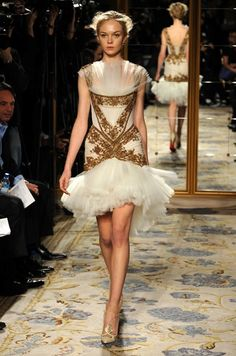 Marchesa 2012. Roman detail struggling to hold onto a tulle explosion.