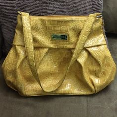 Sagharbor purse This is really nice purse, as you can see in the second picture some stains are factory default Sag Harbor Bags