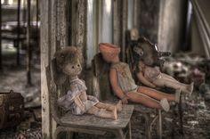 Dolls left behind in an abandoned Pripyat kindergarten.